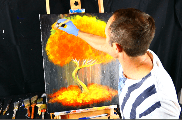 Abstract painting flaming tree round brush on black canvas