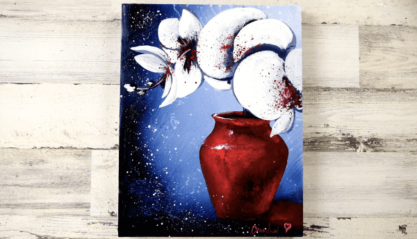 white orchid flowers in beautiful red vase
